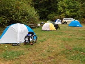 wheelchair in front of a tent