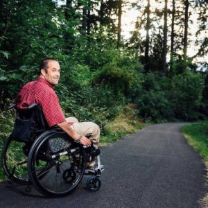 dave pierson in a wheelchair on a paved trail